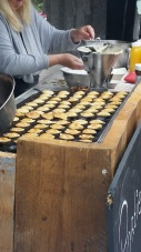 Fresh poffertjes (puff pancakes with butter and sugar) at the Sunday Market