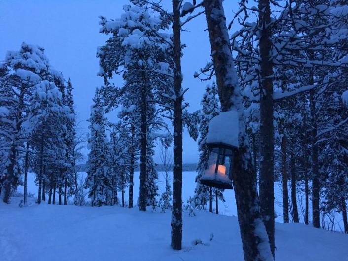 Atmospheric lanterns line the short trail between the dining cabin and our log cabin